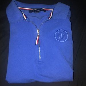 A never before worn blue Tommy Hilfiger tee.